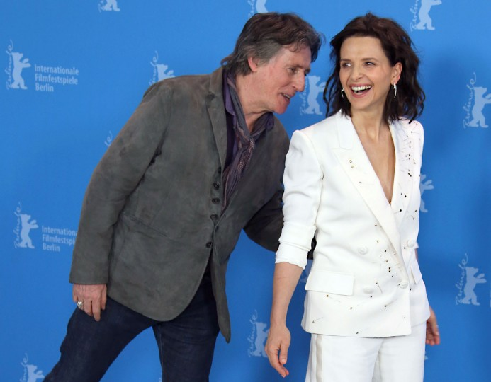 Irish actor Gabriel Byrne speaks with French actress Juliette Binoche as they pose for photographers at the photo call for the film Nobody Wants The Night during the 2015 Berlinale Film Festival in Berlin Thursday, Feb. 5, 2015. (Photo by Joel Ryan/Invision/AP)
