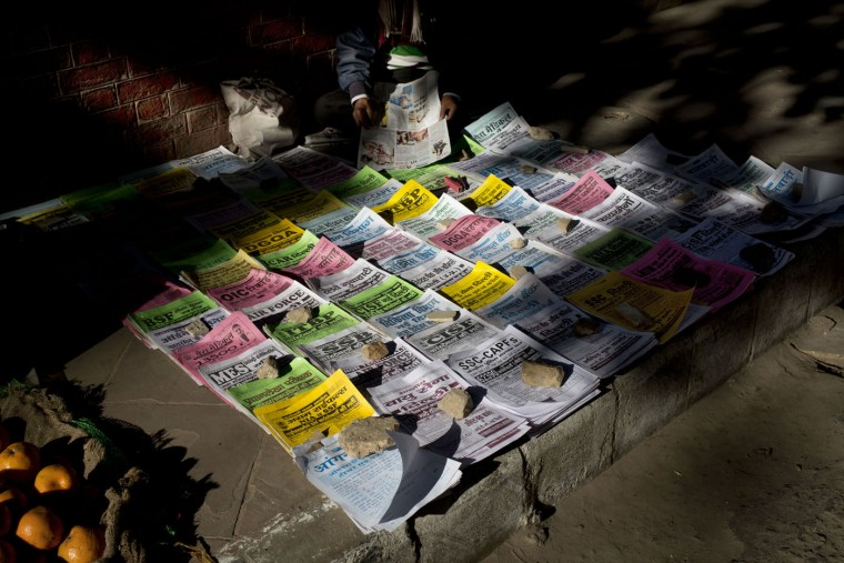 Employment news leaflets and announcements for government jobs are displayed for sale on a street in New Delhi, India, Thursday, Feb. 5, 2015. Government jobs are still the aspired form of employment for many in India because of the stability it provides and most of these jobs require a rigorous competitive examination process. (AP Photo/Bernat Armangue)