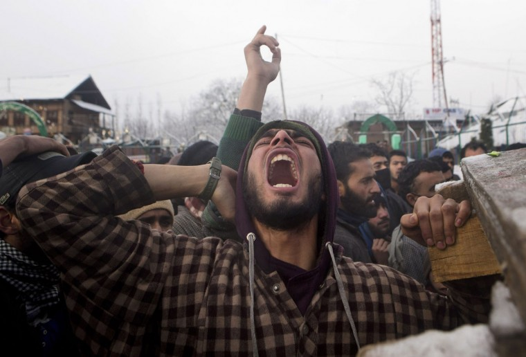 A Kashmiri Muslim villager shouts slogans during the funeral procession of Shabir Ahmed Gania, a suspected rebel in Drubgham, some 55 kilometers (33 miles) south of Srinagar, Indian controlled Kashmir, Thursday, Feb. 26, 2015. Thousands attended the funeral of two suspected rebels killed in a gunbattle with Indian security forces Wednesday in this the disputed Himalayan region. (Dar Yasin/AP Photo)
