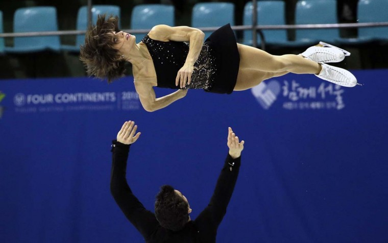 Meagan Duhamel and Eric Radford of Canada perform during the pairs free skating in the ISU Four Continents Figure Skating Championships in Seoul, South Korea. AP Photo/Lee Jin-man