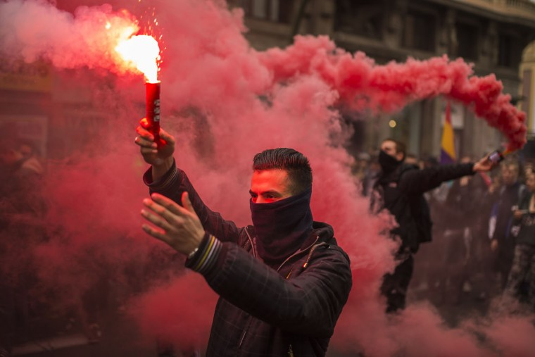 Students march and light flares during the second day of student strike in Madrid, Spain Thursday Feb. 26, 2015. Students across Spain are protesting changes in the system of university degrees with protests and a two-day strike. (Andres Kudacki/AP Photo)