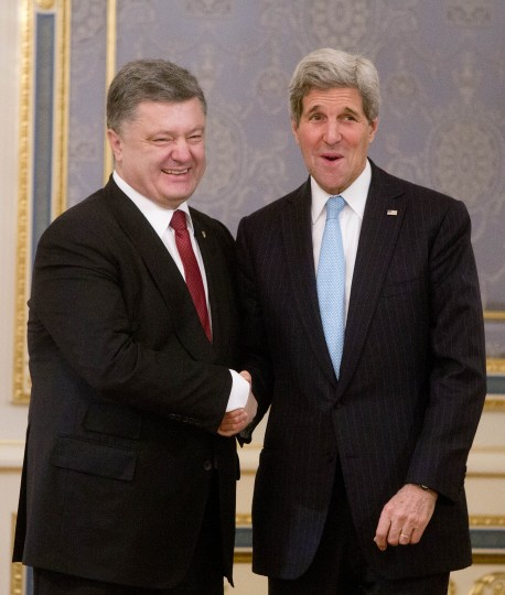 Ukrainian President Petro Poroshenko, left, shakes hands with U.S. Secretary of State John Kerry during a meeting in Kiev, Ukraine, Thursday, Feb. 5, 2015. The Ukrainian government is anxious to use Thursday's visit by U.S. Secretary of State John Kerry to Kiev to reiterate its plea for lethal aid. President Barack Obama has opposed the idea of sending weapons to Ukraine but sources in his administration say this position could change in the light of recent events. (AP Photo/Efrem Lukatsky)