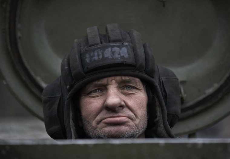 A Russia-backed separatist fighter sits in a self propelled 152 mm artillery piece, part of a unit moved away from the front lines, in Yelenovka, near Donetsk, Ukraine, Thursday, Feb. 26, 2015. Russia's foreign minister is sharply criticizing Ukraine's insistence that it won't begin pulling back heavy weapons in its fight against separatists in the east until the rebels fully observe a cease-fire. (Vadim Ghirda/AP Photo)