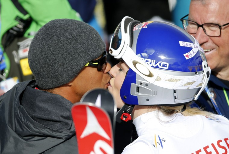 Tiger Woods, left, kisses United States' Lindsey Vonn during the women's giant slalom competition at the alpine skiing world championships on Thursday, Feb. 12, 2015, in Beaver Creek, Colo. (Marco Trovati/AP)