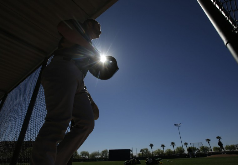 Oakland Athletics' Stephen Vogt (21) walks out of the dugout during spring training baseball practice Wednesday, Feb. 25, 2015, in Mesa, Ariz. (AP Photo/Darron Cummings)