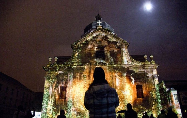Visitors look at a light projection on the St. Pieters Abbey during the light festival in Ghent, Belgium on Sunday, Feb. 1, 2015. More than 40 light installations were on display during the festival, which takes places every three years. (AP Photo/Virginia Mayo)