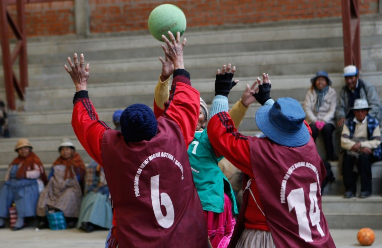 In this Feb. 11, 2105 photo, elderly Aymara indigenous women play handball in El Alto, Bolivia. Team handball is an Olympic sport in which two teams of pass a ball using their hands with the aim of throwing it into the otherís goal. (AP Photo/Juan Karita)