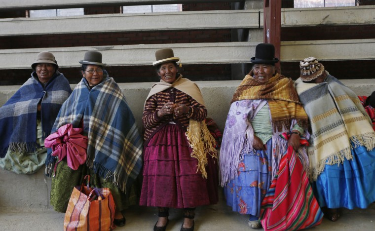 In this Feb. 11, 2105 photo, elderly Aymara indigenous women rest on the bleachers after playing handball in El Alto, Bolivia. Known in the Aymara language as ìawichas,î or grandmothers, the women pull sports jerseys over their long-sleeved blouses and ruffled skirts to play the game. (AP Photo/Juan Karita)