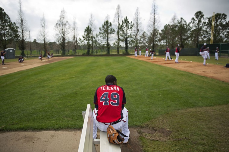 Atlanta Braves pitcher Julio Teheran rests on the bench in the bullpen during a spring training baseball workout, Monday, Feb. 23, 2015, in Kissimmee, Fla. (AP Photo/David Goldman)