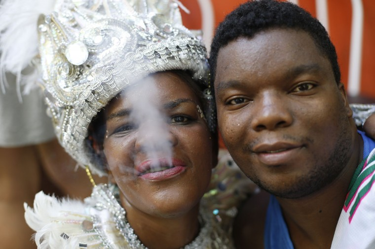 """Patients from the Nise de Silveira mental health institute pose for a portrait during the institute's carnival parade, coined in Portuguese: """"Loucura Suburbana,"""" or Suburban Madness, at the center in Rio de Janeiro, Brazil, Thursday, Feb. 12, 2015. Patients, their relatives and workers from the institute held their parade one day before the official start of Carnival. (AP Photo/Silvia Izquierdo)"""