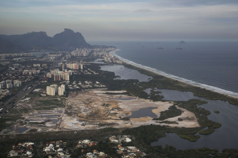 This May 13, 2014 file photo shows the Rio 2016 Olympic golf course under construction in Rio de Janeiro, Brazil. A Rio de Janeiro public prosecutor opened an inquiry on Feb. 6, 2015 into alleged misconduct by Mayor Eduardo Paes over the construction of the golf course for the 2016 Olympics in a nature reserve. (AP Photo/Felipe Dana, File)
