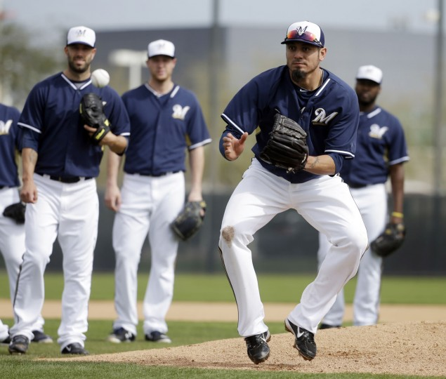 Milwaukee Brewers' Matt Garza catches a ball during a spring training baseball workout Sunday, Feb. 22, 2015, in Phoenix. (AP Photo/Morry Gash)