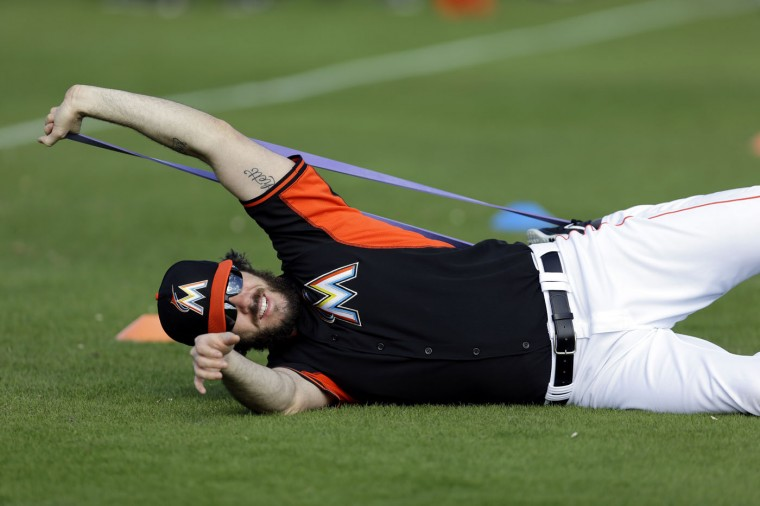 Miami Marlins pitcher Dan Haren stretches during spring training baseball practice Sunday, Feb. 22, 2015, in Jupiter, Fla. (AP Photo/Jeff Roberson)