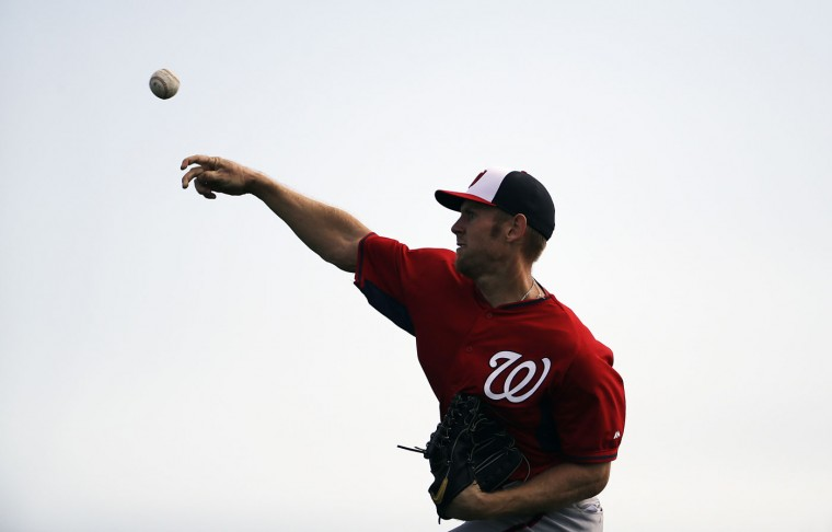 Washington Nationals pitcher Stephen Strasburg throws the ball during a spring training baseball workout, Sunday, Feb. 22, 2015, in Viera, Fla. (AP Photo/David Goldman)
