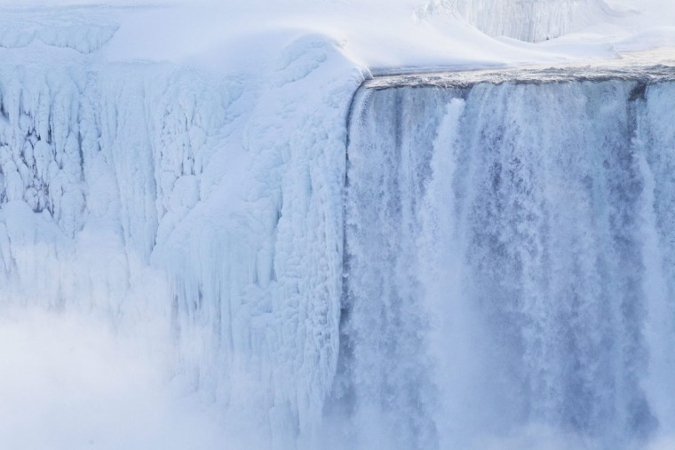 Masses of ice form around the Canadian 'Horseshoe' Falls as seen from Niagara Falls, Ontario, Canada, Thursday, Feb. 19, 2015. (AP Photo/The Canadian Press/Aaron Lynett)