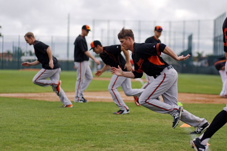 Baltimore Orioles pitcher Tyler Wilson, foreground, runs sprints with teammates during a spring training baseball workout in Sarasota, Fla., Monday, Feb. 23, 2015. The Orioles full squad has it's first official workout Feb. 25. (AP Photo/Gene J. Puskar)
