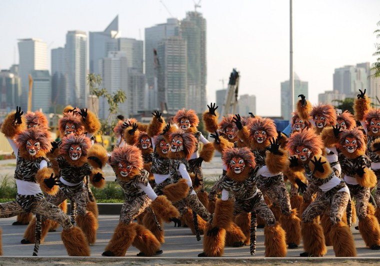 "Filipino residents wearing costumes pose as they perform during the start of the annual ""Caracol"" festival in suburban Makati, south of Manila, Philippines on Sunday, Feb. 22, 2015. The event aims to promote public awareness on environmental issues and cultural heritage. Filipino students dressed as fish wait for their turn during the annual ""Caracol"" festival in suburban Makati, south of Manila, Philippines on Sunday, Feb. 22, 2015. The event aims to promote public awareness on environmental issues and cultural heritage. (AP Photo/Aaron Favila)"