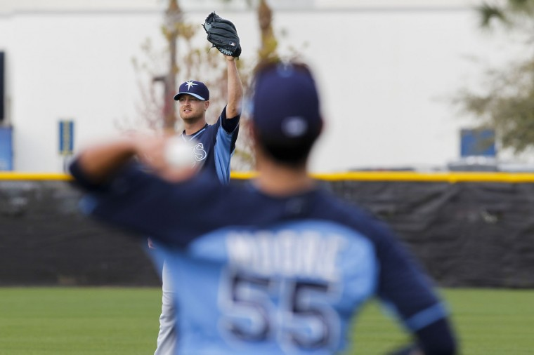 Tampa Bay Rays starting pitcher Alex Cobb (53) warms up during a spring training baseball workout, Monday, Feb. 23, 2015, in Port Charlotte, Fla. (AP Photo/The Tampa Bay Times, Will Vragovic)