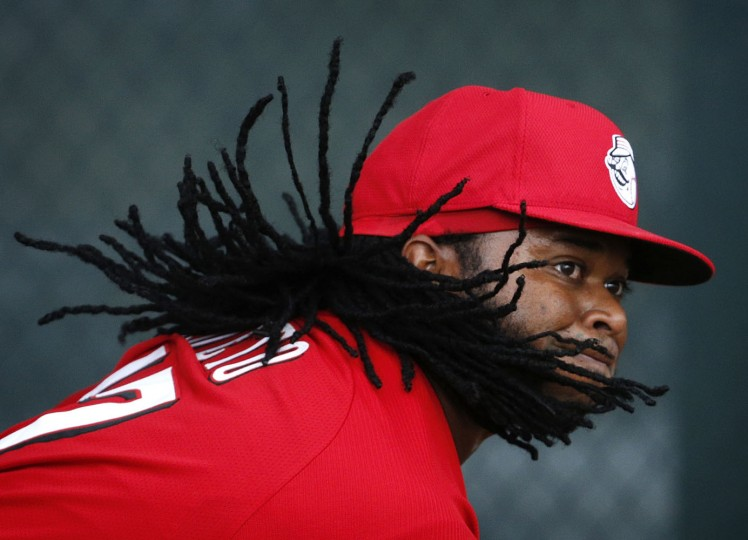 Cincinnati Reds' Johnny Cueto's hair bounces around as he throws during a spring training baseball workout Monday, Feb. 23, 2015, in Goodyear, Ariz. (AP Photo/John Locher)
