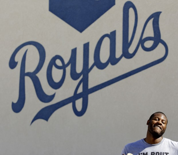 Kansas City Royals' Lorenzo Cain during spring training baseball practice Friday, Feb. 20, 2015, in Surprise, Ariz. (AP Photo/Charlie Riedel)