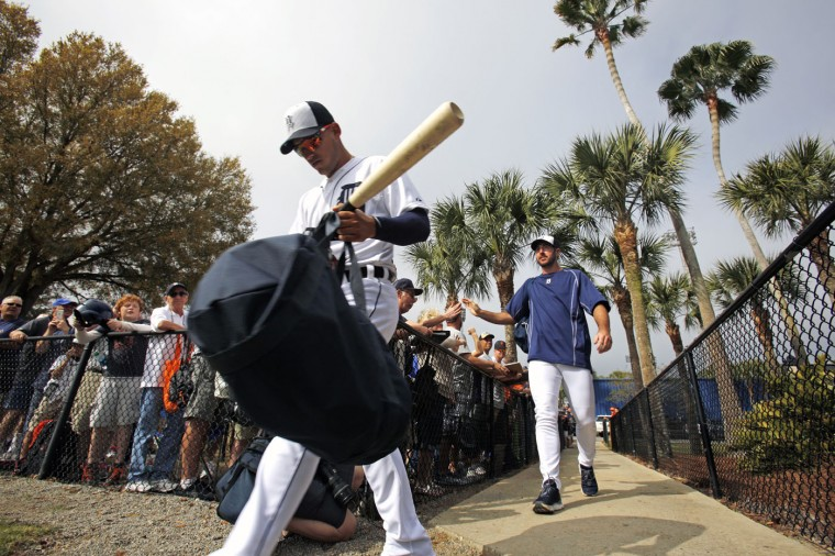 Detroit Tigers shortstop Jose Iglesias, left, and pitcher Justin Verlander arrive for a spring training baseball workout in Lakeland, Fla., Tuesday, Feb. 24, 2015. (AP Photo/Gene J. Puskar)