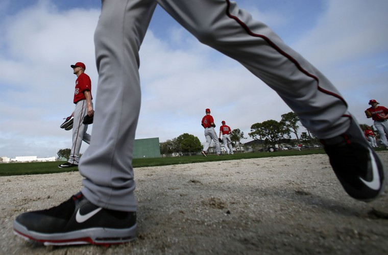 The Minnesota Twins begin a morning workout at baseball spring training in Fort Myers Fla., Tuesday Feb. 24, 2015. (AP Photo/Tony Gutierrez)