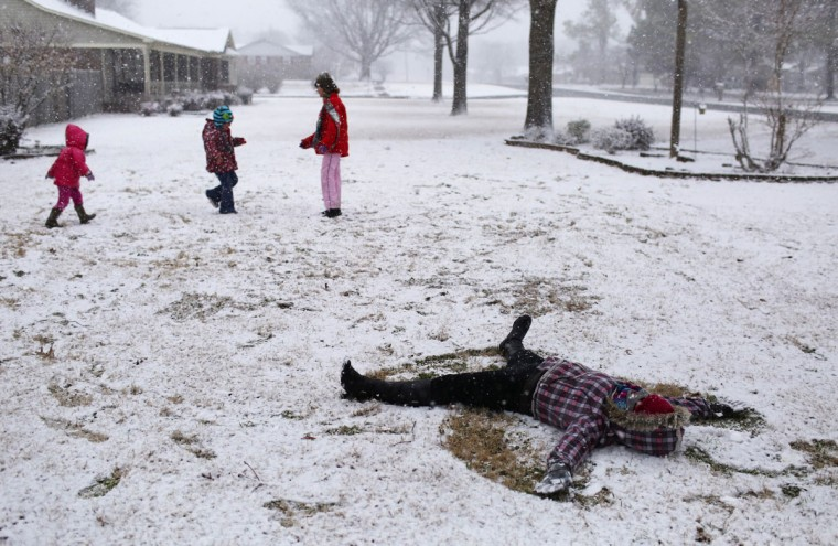 Sorcha Davis makes a snow angel Wednesday, Feb. 25, 2015, in Muscle Shoals, Ala. From the Deep South to the Mid-Atlantic. (AP Photo/The TimesDaily, Allison Carter)