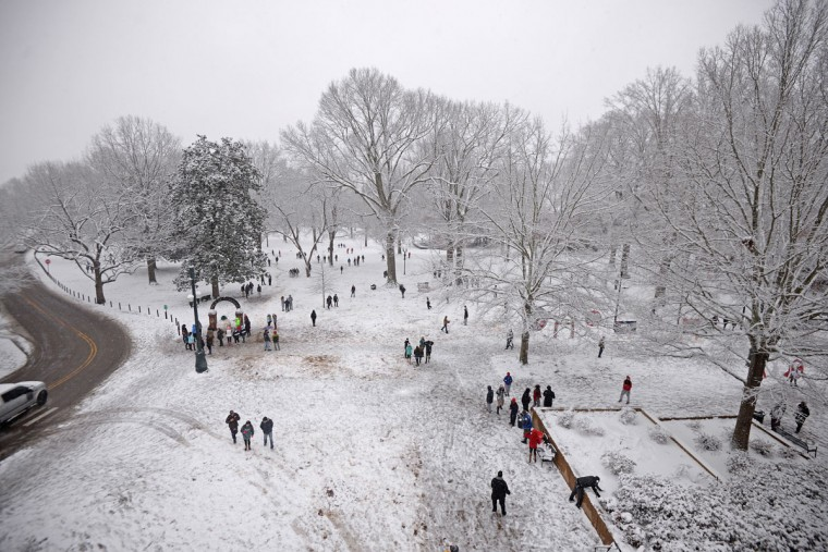 Students walk in The Grove on the University of Mississippi campus Wednesday, Feb. 25, 2015, in Oxford, Miss. (AP Photo/The Daily Mississippian, Thomas Graning)