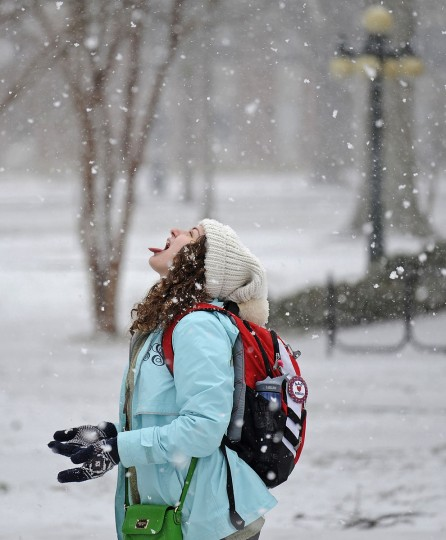 Sydney Standard catches snowflakes on the University of Mississippi campus Wednesday, Feb. 25, 2015, in Oxford, Miss. (AP Photo/The Daily Mississippian, Thomas Graning)