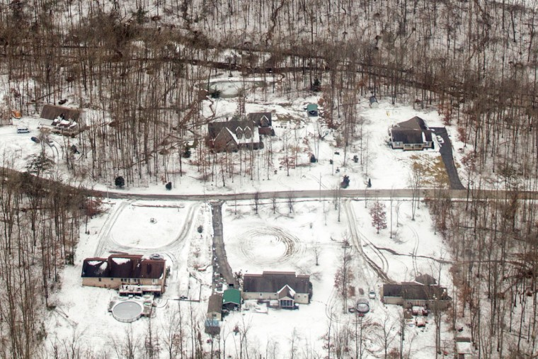 Ice and snow are seen near homes from a National Guard helicopter on the Cumberland Plateau near Crossville, Tenn., Tuesday, Feb. 24, 2015. Tennessee Gov. Bill Haslam joined state officials in touring damage from the storm, and urged people to check on their neighbors as the death toll from the storm climbs. (AP Photo/Erik Schelzig)