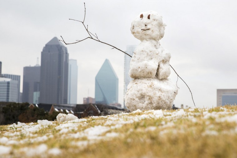 A snowman sits atop a small hill in Griggs Park near downtown Dallas after a winter storm dumped snow over North Texas, Wednesday, Feb. 25, 2015. (AP Photo/The Dallas Morning News, Smiley N. Pool)