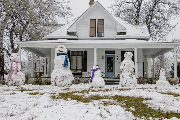 Snowmen line the front yard of a home on East Hubbard St. in Lindale, Texas, Wednesday Feb. 25, 2015. A snowstorm brought an unusual amount of winter precipitation to the East Texas area. (AP Photo/The Tyler Morning Telegraph, Clint Jones)