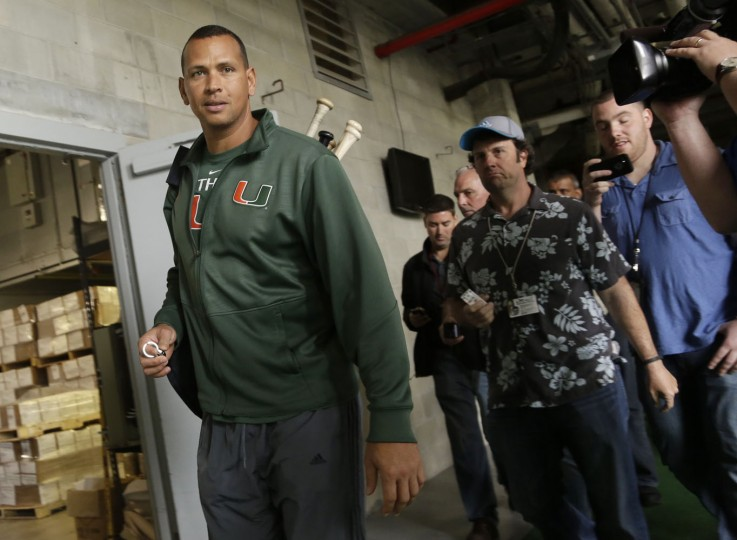 New York Yankees' Alex Rodriguez, left, leaves the stadium after completing a physical during spring training baseball, Wednesday, Feb. 25, 2015, in Tampa, Fla. The first official workout for the full squad is Thursday. (AP Photo/Lynne Sladky)