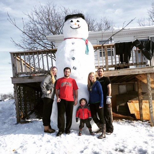Peyton Goretsas, 3, poses with a 14-foot snowman in Manchester. To his left are Tom Goretsas and Lyndsey Grimm, and to his right are Kelsey Franklin and Mason Goretsas. (Photo courtesy of Kelsey Franklin)