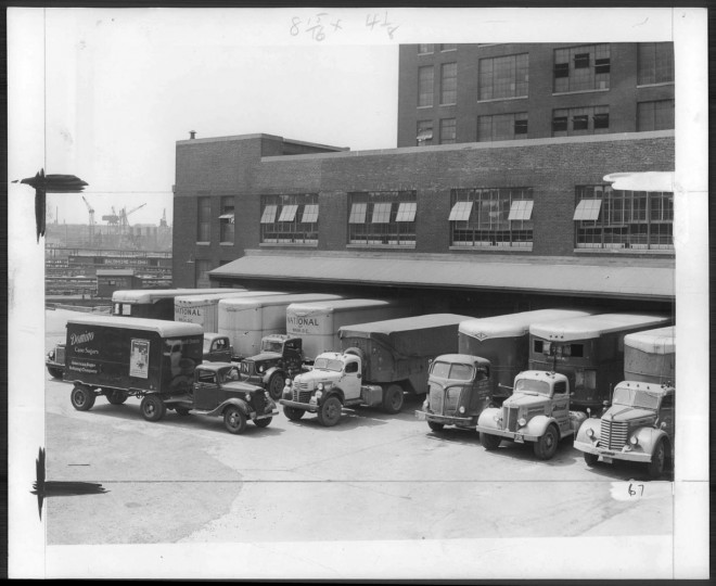 July 26, 1950: The Sugar Refinery in Locust Point loads 150 trucks a day. Photo by Joshua S. Cosden.