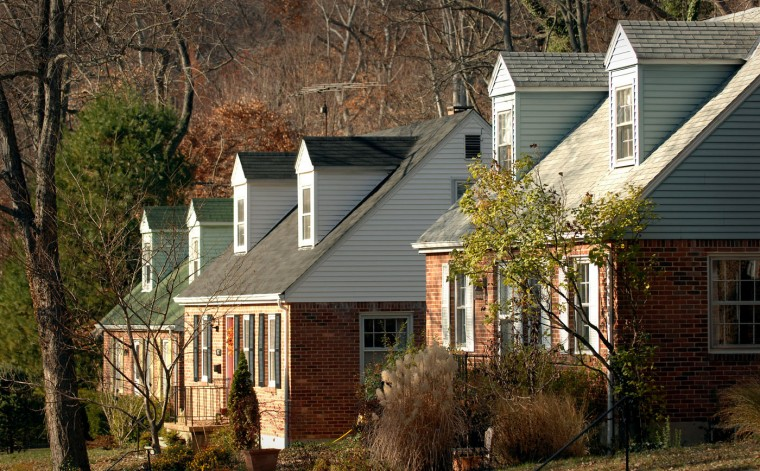 A stretch of similarly designed homes line the street of Fairbank Rd. in Mt. Washington. Glenn Fawcett, Sun file photo, 11/27/07.