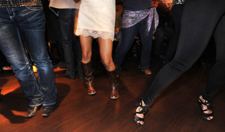 "Nancy Alers, alias Nancy ""Salsa,"" far right, demonstrates salsa footwork. (Algerina Perna/Baltimore Sun)"