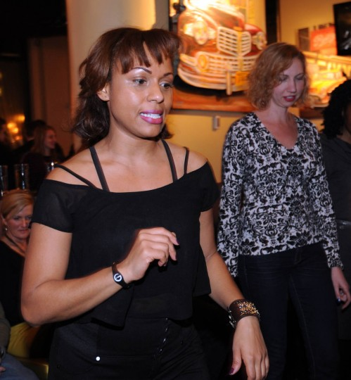 """Nancy Alers, alias Nancy """"Salsa,"""" with Sentimiento Latin Dance Company, counts out the rhythm and timinig. The Dance Company teaches the class in partnership with Rueda de Casino Baltimore. (Algerina Perna/Baltimore Sun)"""