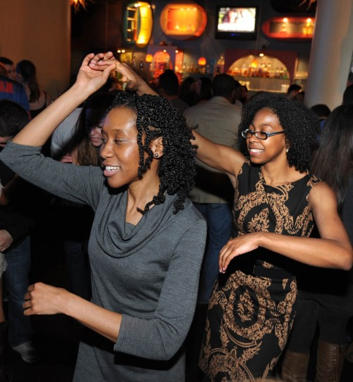 Larissa Jennings, left, and Casey Overby perfect their salsa dancing. (Algerina Perna/Baltimore Sun)