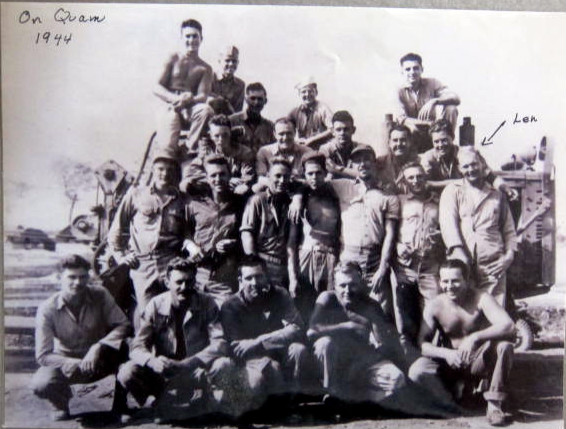 "The Marine unit on Guam in 1944. They sailed from Guam to Iwo. As told by Len Pojunas Jr., ""My dad is the tall Marine standing far right. Standing immediately to the left is Frank Hoyt. One more to the left looks like Martini, with the mustache. Then Hill and Jones appear (one with his cap brim turned up). The Marine, Hyatt, killed by the booby-trapped wooden box is there, but I don't know which. """