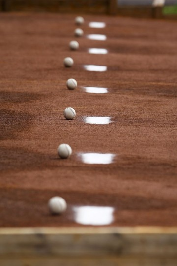 Baseballs are lined up in the bullpen ready for the first official workout of Rays Spring Training at Charlotte Sports Park in Port Charlotte, Fla., on Monday, Feb. 23, 2015. (Will Vragovic/Tampa Bay Times/TNS)
