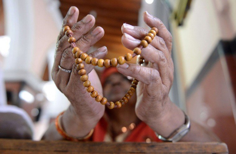 An Indian Catholic Christian holding a rosary offers prayers during an Ash Wednesday service at Saint Mary's Basilica in Secunderabad, the twin city of Hyderabad, on February 18, 2015. (NOAH SEELAM/AFP/Getty Images)