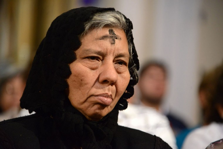 A Catholic woman attends mass to celebrate Ash Wednesday, marking the beginning of Lent -- a period of penitence for Christians before Easter -- in Tegucigalpa, Honduras, on February 18, 2015. (ORLANDO SIERRA/AFP/Getty Images)