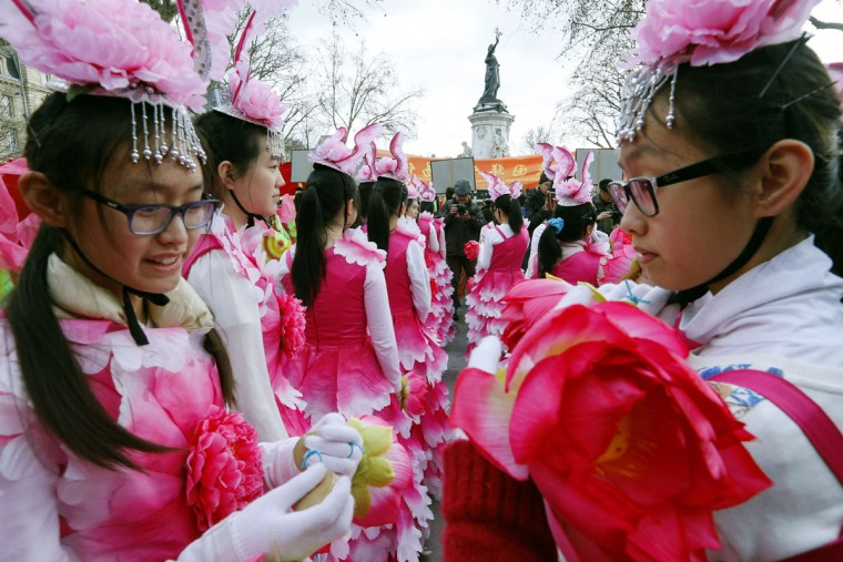 Members of the Marais district Chinese community celebrate the Chinese Lunar New Year on February 21, 2015, in central Paris. (FRANCOIS GUILLOT/AFP/Getty Images)