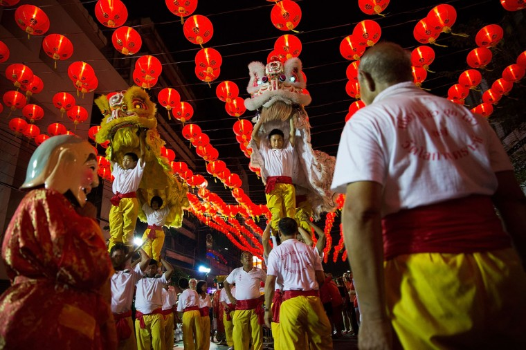 A group performs a dragon on February 19, 2015 in Bangkok, Thailand. February 19 marks the first day of the Chinese lunar calendar and is celebrated amongst Bangkok's significant ethnically Chinese population. (Photo by Taylor Weidman/Getty Images)