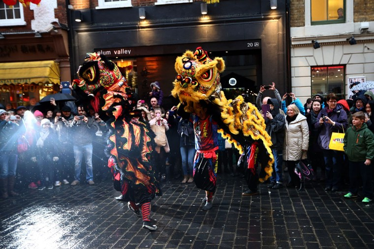 Dragon dancers perform in China Town during Chinese New Year celebrations on February 19, 2015 in London, England. This Sunday will see the largest Chinese New Year celebrations in Europe as performers and members of the Chinese community in the UK celebrate the year of the sheep. (Photo by Carl Court/Getty Images)