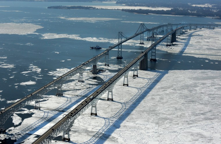 A ship makes its way south after passing beneath the Bay Bridge and the ice on the Chesapeake Bay. (Lloyd Fox/Baltimore Sun)