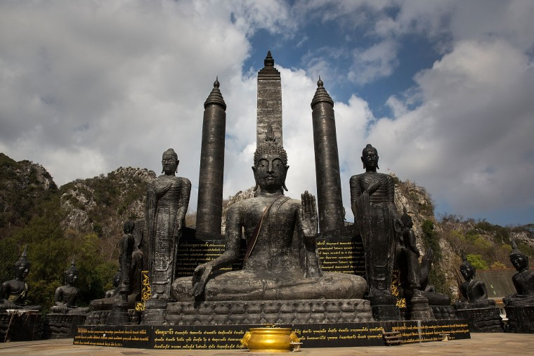 Large black stone statues stand at the entry to the temple at Wat Tham Krabok in Saraburi, Thailand. Wat Tham Krabok is the largest free drug rehabilitation center in Thailand and offers its 7 to 28 day detoxification courses to both locals and foreigners. (Taylor Weidman/Getty Images AsiaPac)