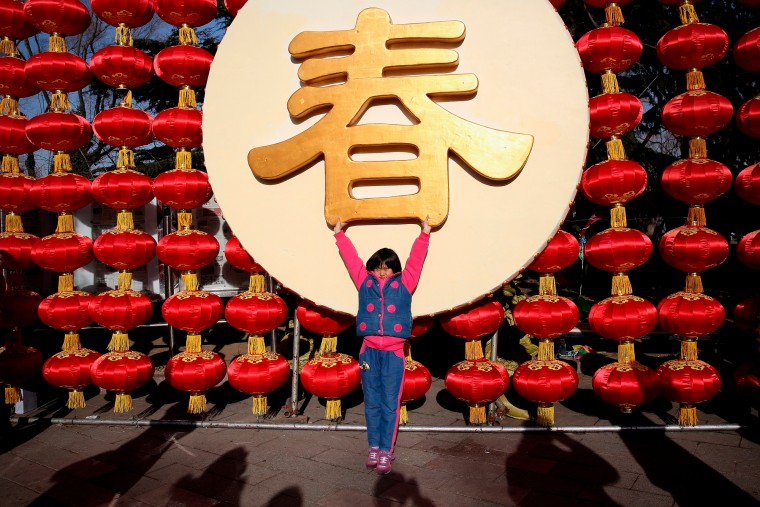 A little girl poses for photos as she and her family visit a temple fair to celebrate the Lunar New Year of Sheep during serious pollution in Beijing, China. The Chinese Lunar New Year of Sheep also known as the Spring Festival, which is based on the Lunisolar Chinese calendar, is celebrated from the first day of the first month of the lunar year and ends with Lantern Festival on the Fifteenth day. (Feng Li/Getty Images AsiaPac)