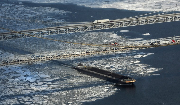 A tugboat pushes a barge through the and under the Bay Bridge as it makes way south on the Chesapeake Bay. (Lloyd Fox/Baltimore Sun)(Lloyd Fox/Baltimore Sun)(Lloyd Fox/Baltimore Sun)(Lloyd Fox/Baltimore Sun)
